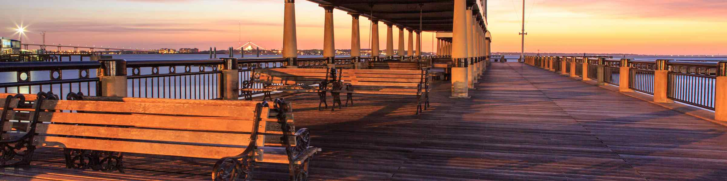 Sunset view of the pier at Waterfront Park, Charleston, SC.